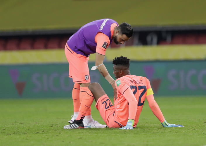 Ecuador's goalkeeper Alexander Dominguez, bottom, reacts after losing 2-0 against Brazil at the end of a qualifying soccer match for the FIFA World Cup Qatar 2022 at Beira-Rio stadium in Porto Alegre, Brazil, Friday, June 4, 2021. (AP Photo/Andre Penner)