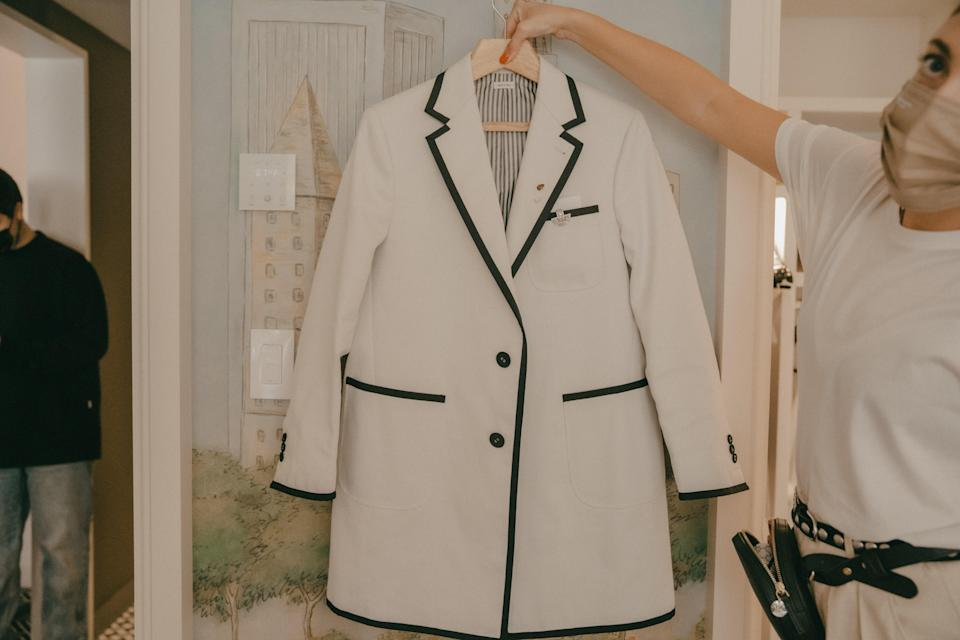 A polished suit jacket, or rather, a Thom Browne signature.