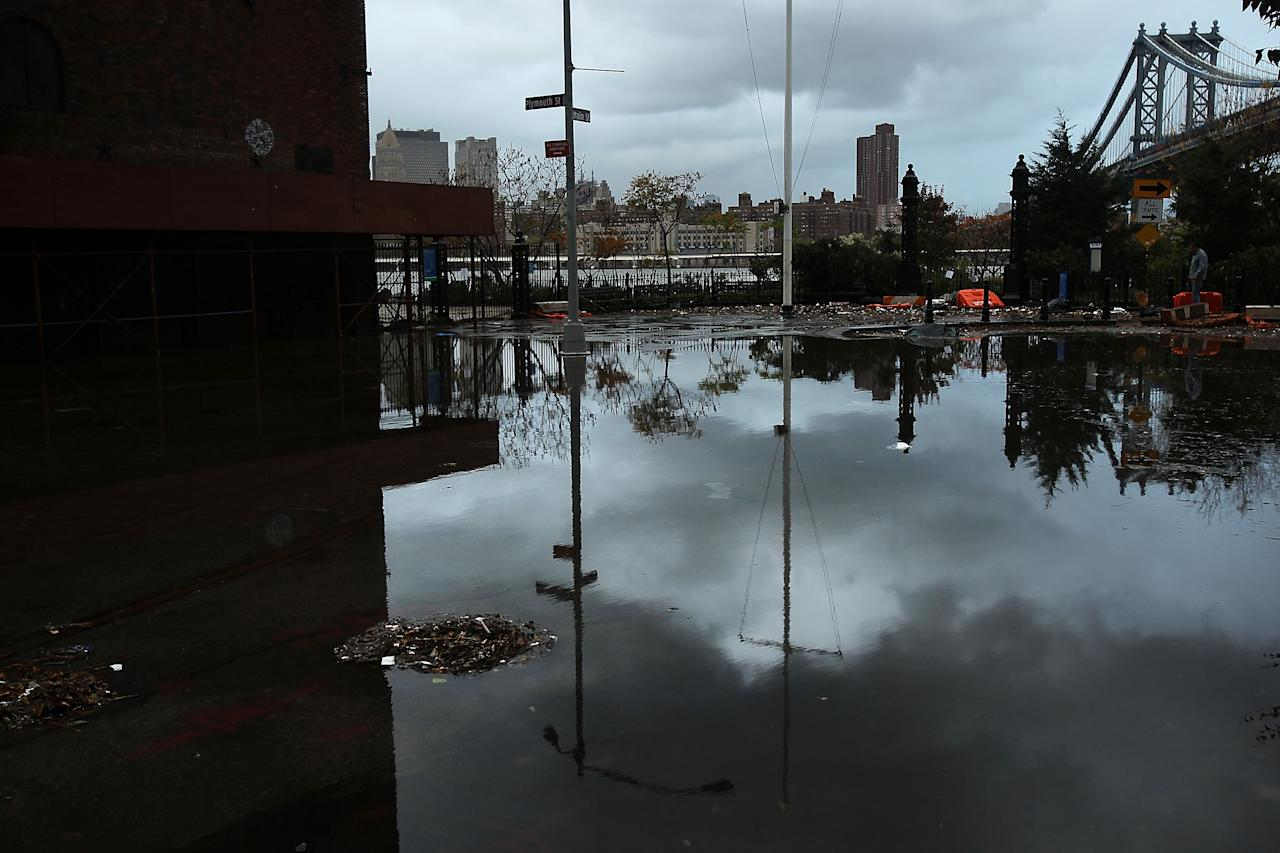 NEW YORK, NY - OCTOBER 30:  A flooded street in the Dumbo section of Brooklyn is viewed after the city awakens to the affects of Hurricane Sandy on October 30, 2012 in New York, United States. At least 15 people were reported killed in the United States by Sandy as millions of people in the eastern United States have awoken to widespread power outages, flooded homes and downed trees. New York City was his especially hard with wide spread power outages and significant flooding in parts of the city.  (Photo by Spencer Platt/Getty Images)