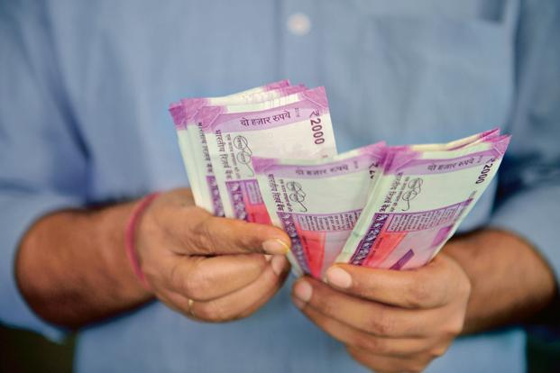 Rupee closes stronger as RBI eases overseas borrowing rules
