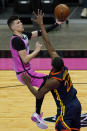 Miami Heat guard Tyler Herro (14) drives to the basket over Golden State Warriors forward Andrew Wiggins (22) during the second half of an NBA basketball game, Thursday, April 1, 2021, in Miami. (AP Photo/Marta Lavandier)