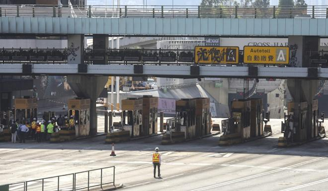 A clean-up process is under way at the Cross-Harbour Tunnel toll booths in Hung Hom. Photo: Dickson Lee