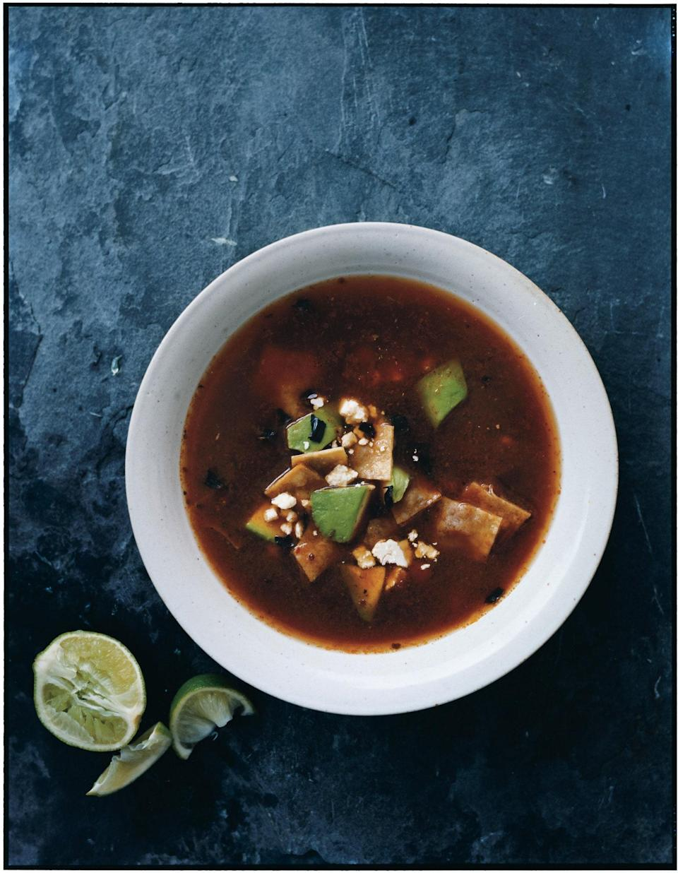 """Tortilla soup is all about contrasting textures, but its real success hinges on a fabulous broth—in this case, homemade chicken stock enriched with a cooked purée of chiles, tomatoes, onion, and garlic. <a href=""""https://www.epicurious.com/recipes/food/views/tortilla-soup-with-chiles-and-tomatoes-351417?mbid=synd_yahoo_rss"""" rel=""""nofollow noopener"""" target=""""_blank"""" data-ylk=""""slk:See recipe."""" class=""""link rapid-noclick-resp"""">See recipe.</a>"""
