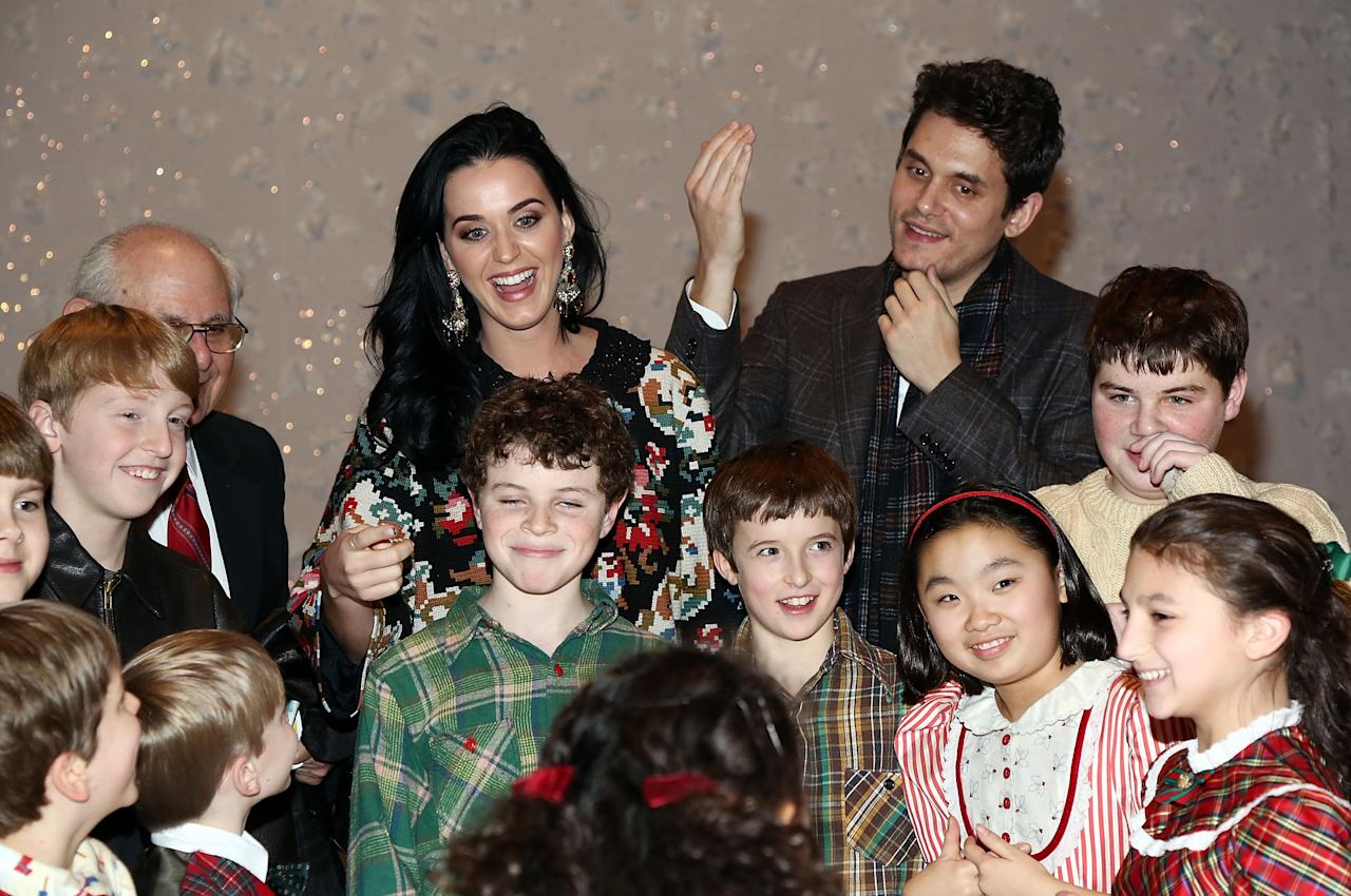 "NEW YORK, NY - DECEMBER 12:  (L-R)  Katy Perry and John Mayer pose for photos with cast members from ""A Christmas Story, The Musical"" Broadway Performance at Lunt-Fontanne Theatre on December 12, 2012 in New York City.  (Photo by Astrid Stawiarz/Getty Images)"