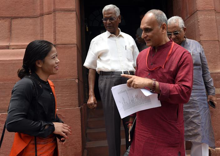 Rajya Sabha MP Mary Kom talks with BJP MP Rakesh Sinha and CPI MP D Raja during the Budget Session at Parliament complex on July 16, 2019 in New Delhi. (Photo by Sonu Mehta/Hindustan Times via Getty Images)