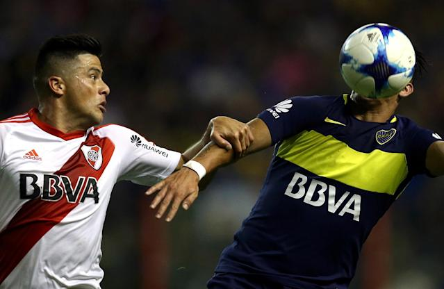 <p>Boca Juniors' Cristian Pavon in action against River Plate's Jorge Moreira at the Argentine First Division soccer match at Alberto J. Armando stadium, Buenos Aires, Argentina on May 15, 2017. (Photo: Marcos Brindicci/Reuters) </p>