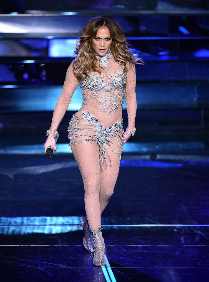 <p>Lopez shook off her oversize fur coat to strut in a custom Zuhair Murad sparkly bikini outfitted over a mesh bodysuit. <i>(Photo: Getty Images)</i></p>