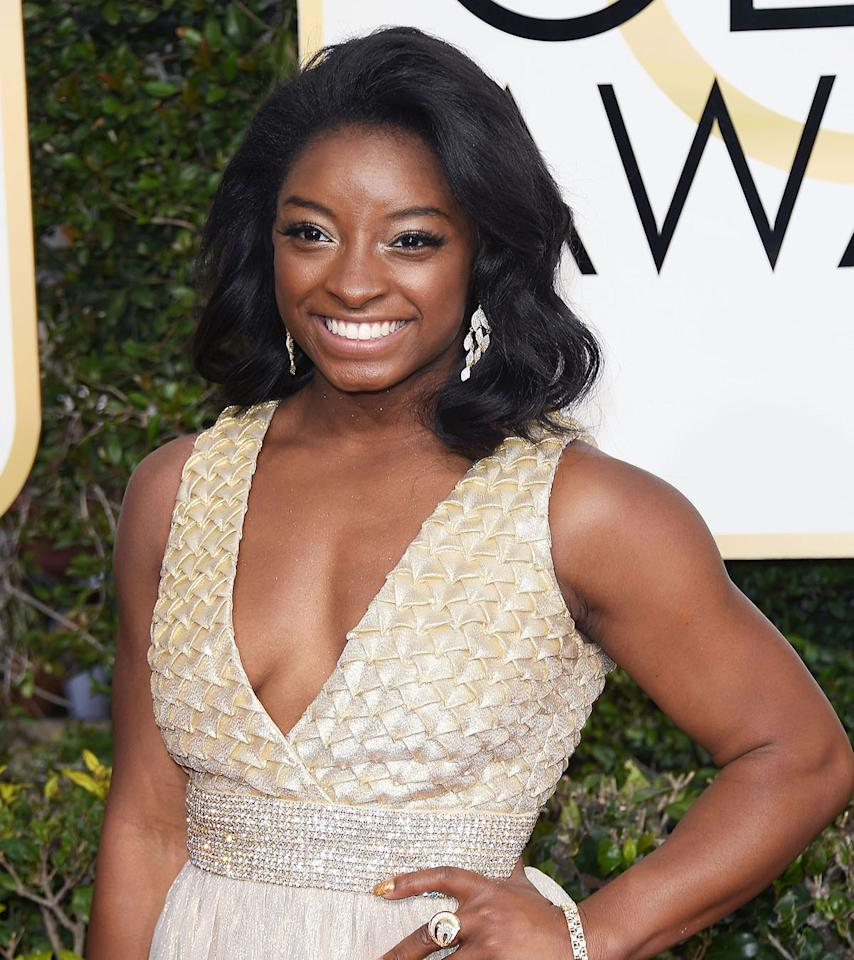 <p>Simone Biles is effortlessly chic with perfect curls and a bright smile. </p>