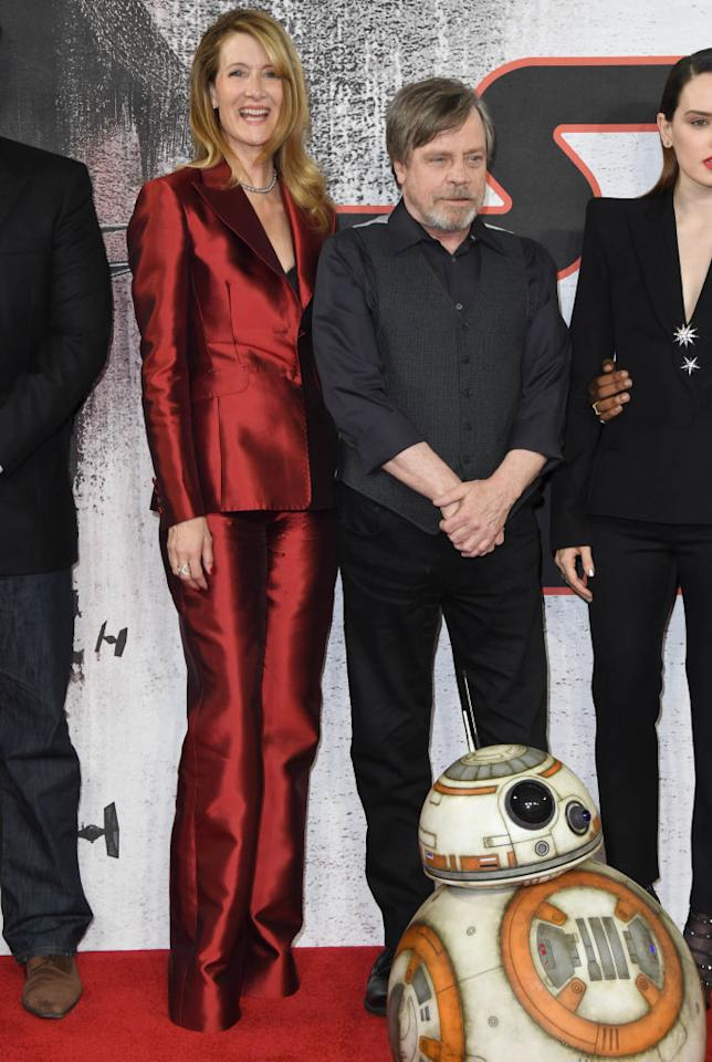 <p>The always graceful Laura Dern, seen here with Mark Hamill, brought some holiday spirit and pantsuit-nation power to the <em>Star Wars</em> red carpet in her shiny scarlet tuxedo. (Photo: Getty Images) </p>
