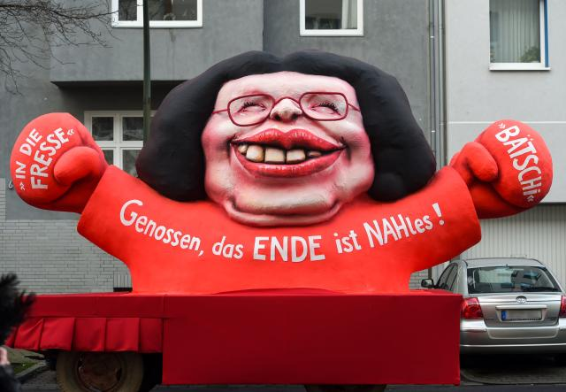 "<p>A carnival float featuring the parliamentary group leader of the Social Democratic Party (SPD) Andrea Nahles is pictured during a carnival parade on Rose Monday on Feb. 12, 2018 in Duesseldorf, western Germany. Inscription reads ""Comrades, the end is near / Nahles"" playing on the word ""nah"" meaning ""near"" in German. (Photo: Patrik Stollarz/Getty Images) </p>"