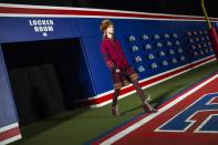 A model enters the arena during rehearsals for the Tommy Hilfiger Fall/Winter 2015 collection at the New York Fashion Week February 16, 2015. Shunning the traditional catwalk, Mr. Hilfiger instead presented his collection on a mock American Football field. REUTERS/Andrew Kelly (UNITED STATES - Tags: FASHION)