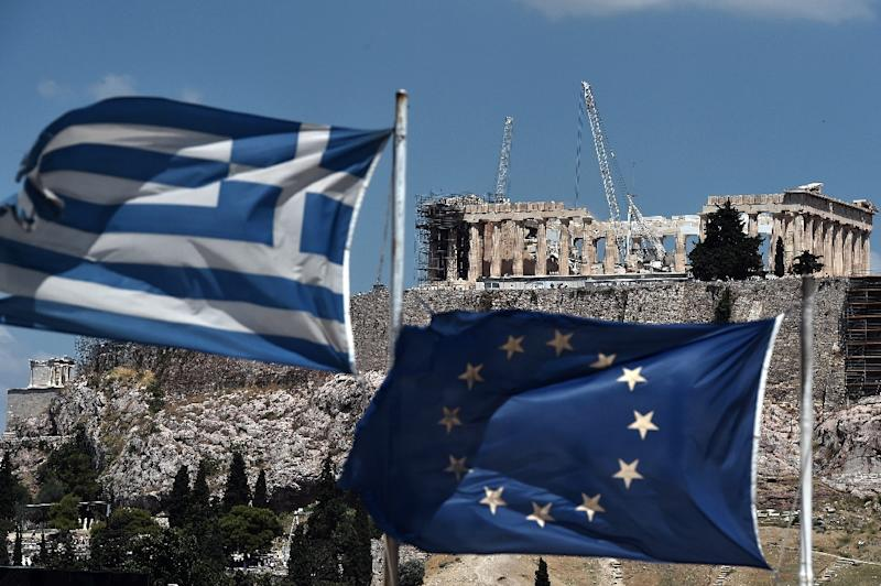 There are deep divisions between European creditors led by Germany, and the IMF, which believes that the Europeans' expectations of Greece's economic performance are too ambitious (AFP Photo/Aris MESSINIS)