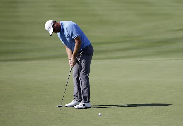 Peter Hanson of Sweden watches his birdie putt on the 18th green on the opening round of the Byron Nelson Championship golf tournament, Thursday, May 15, 2014, in Irving, Texas. Hanson finished the day at 5-under par. (AP Photo/Tony Gutierrez)