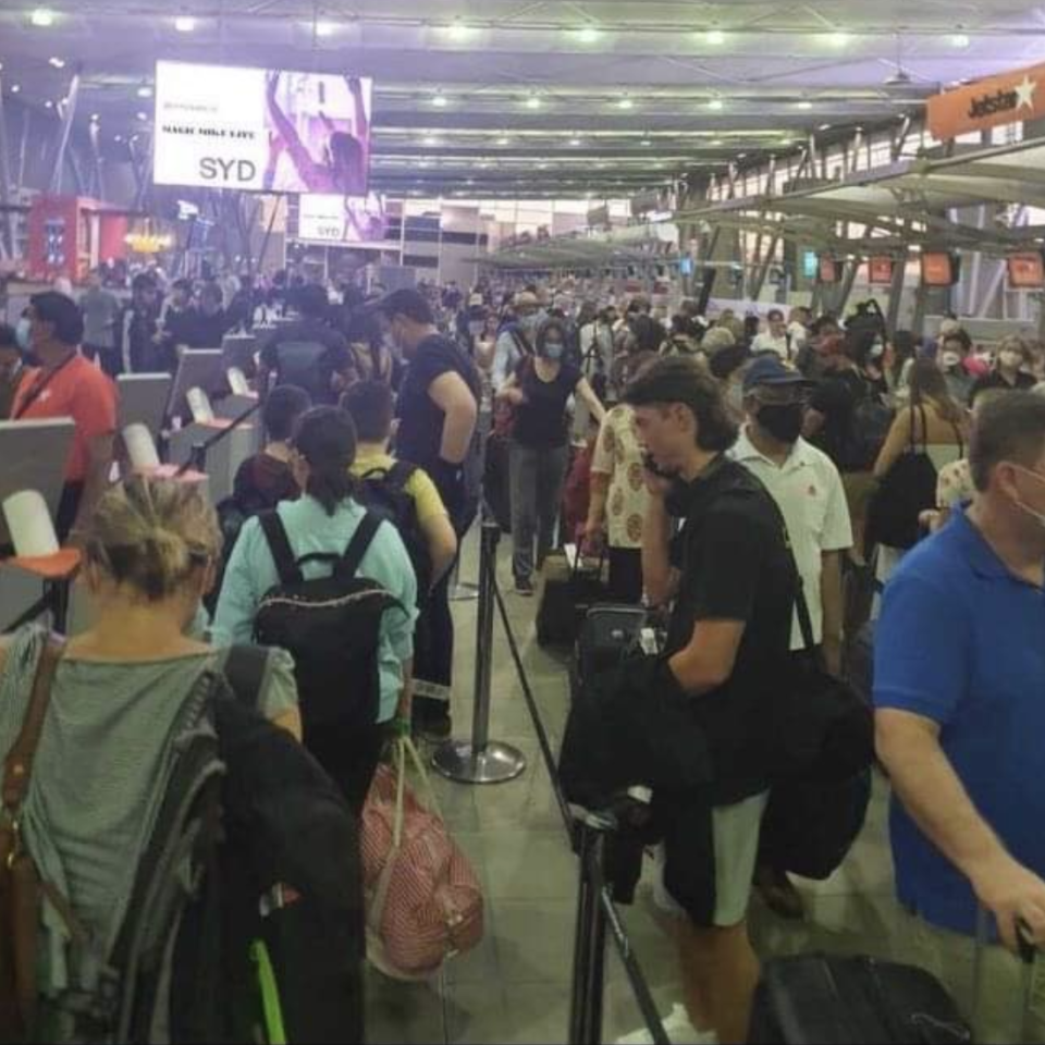 Chaos at Sydney Airport as huge crowds queue and fail to social distance.