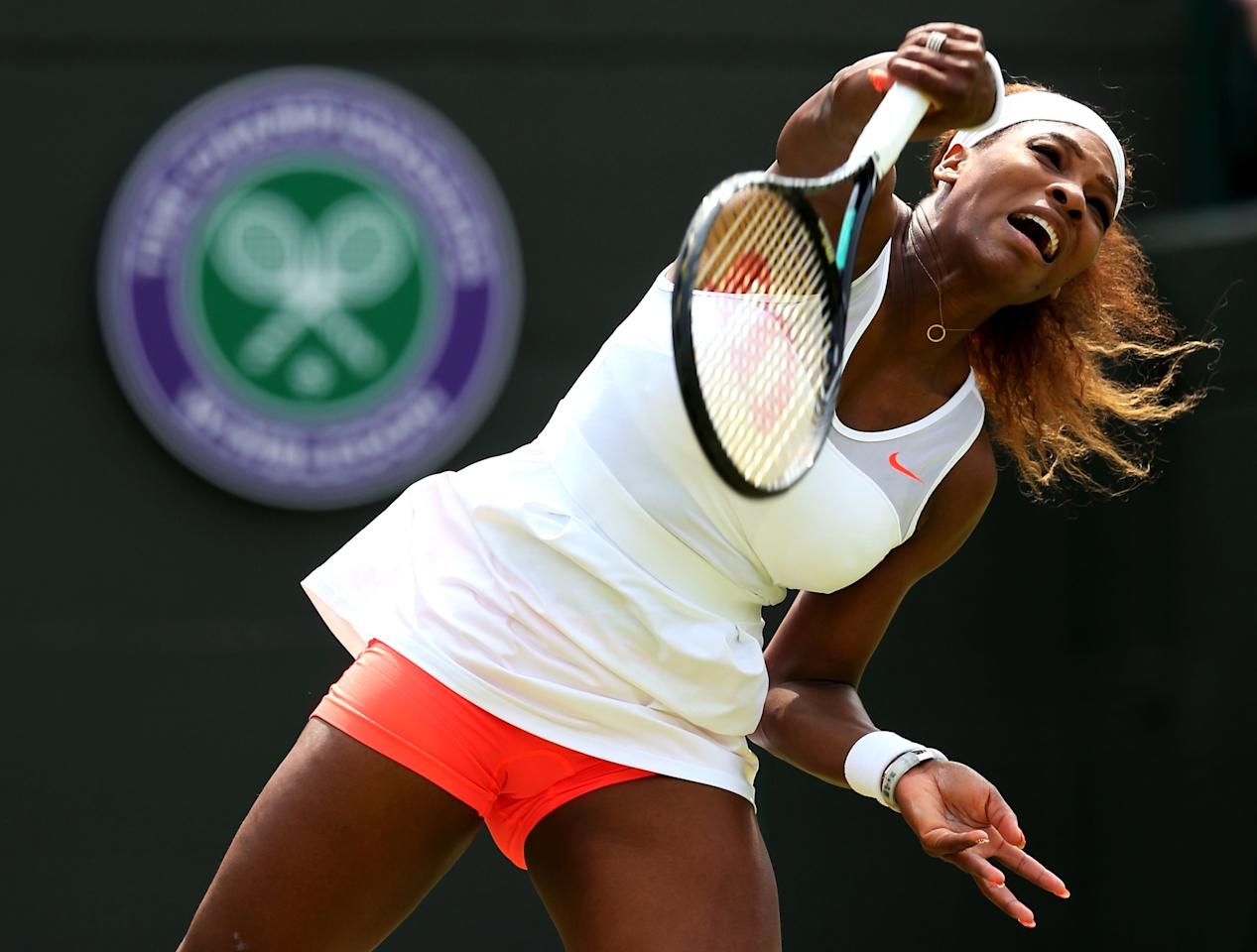 LONDON, ENGLAND - JUNE 27: Serena Williams of the United States of America serves during the Ladies' Singles second round match against Caroline Garcia of France on day four of the Wimbledon Lawn Tennis Championships at the All England Lawn Tennis and Croquet Club on June 27, 2013 in London, England. (Photo by Julian Finney/Getty Images)