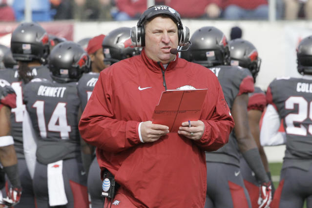 In this photo taken Nov. 23, 2013, Arkansas coach Bret Bielema walks onto the field in the first half of an NCAA college football game against Mississippi State in Little Rock, Ark. After an unsuccessful first season, including nine straight losses to end the season, Bielema returns for his second year with the Razorbacks in 2014. (AP Photo/Danny Johnston)