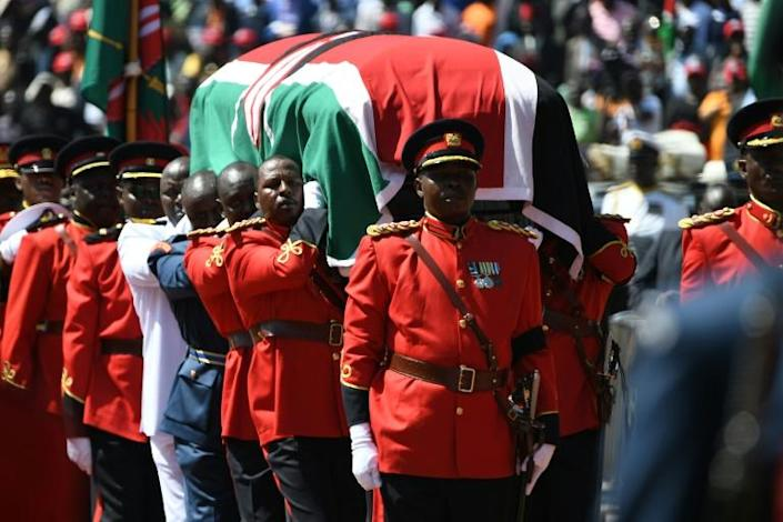 Military officers carried the coffin, which was draped with the national flag (AFP Photo/SIMON MAINA)