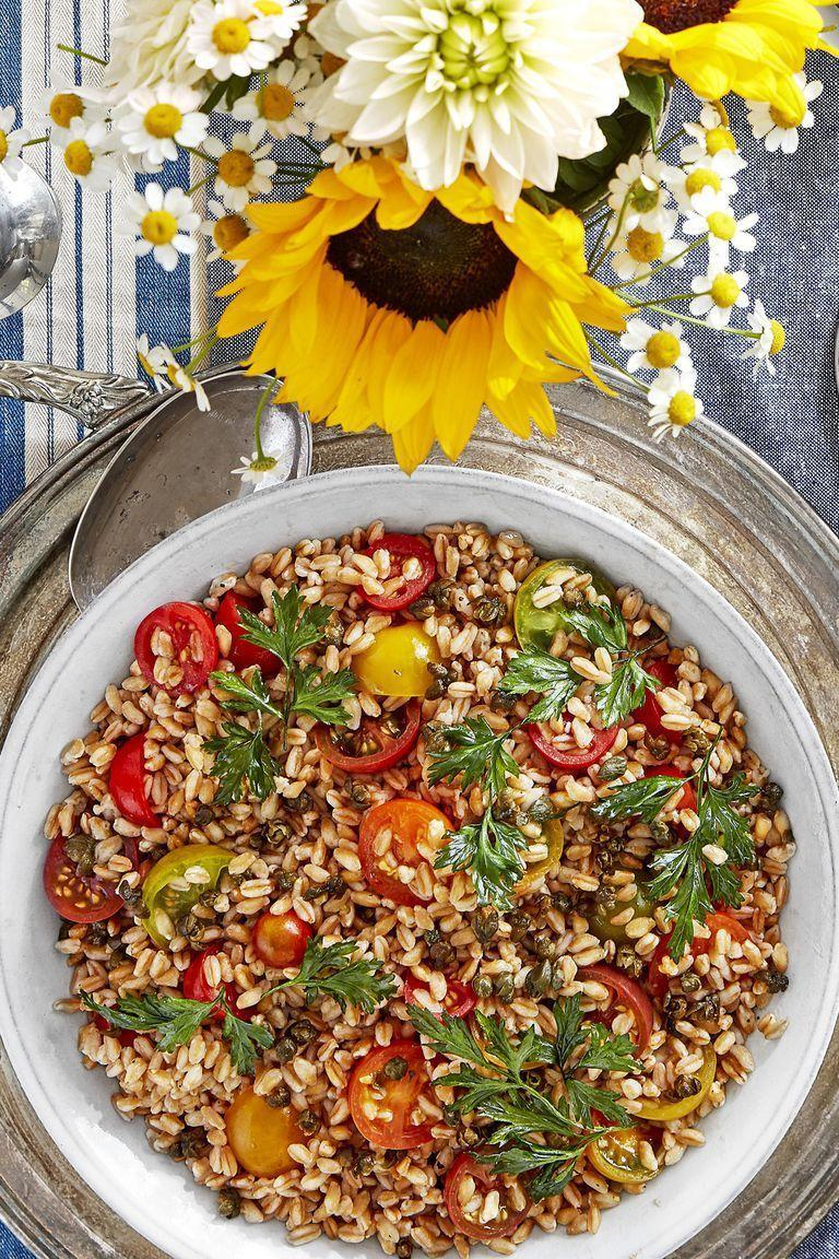 """<p>Crispy capers add an amazing amount of flavor, and are well worth learning. Top this tomato-filled salad with fresh flat-leaf parsley.</p><p><strong><a href=""""https://www.countryliving.com/food-drinks/a22665680/farro-and-tomato-salad-with-crispy-capers-recipe/"""" rel=""""nofollow noopener"""" target=""""_blank"""" data-ylk=""""slk:Get the recipe"""" class=""""link rapid-noclick-resp"""">Get the recipe</a>.</strong></p>"""