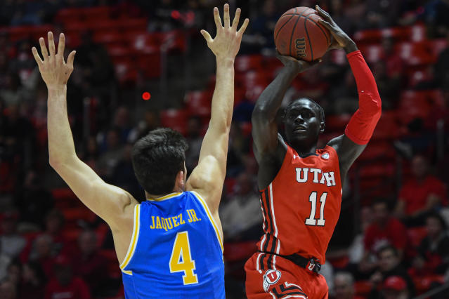Utah guard Both Gach (11) shoots over UCLA guard Jaime Jaquez Jr. (4) during the second half of an NCAA college basketball game Thursday, Feb. 20, 2020, in Salt Lake City. (AP Photo/Alex Goodlett)