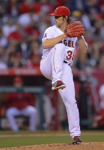 Los Angeles Angels pitcher C.J. Wilson delivers against the Chicago White Sox in the first inning of a baseball game, Friday, May 17, 2013 in Anaheim, Calif. (AP Photo/Mark J. Terrill)