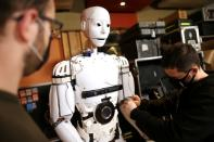 """Almir Besic (L), former student of the Electrical Engineering Faculty and Vedran Mujagic, member of rock group """"Dubioza Kolektiv"""" fix humanoid robot called """"Robby Megabyte"""" in Sarajevo"""