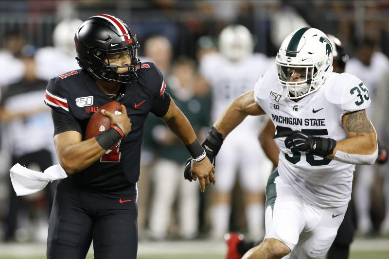 Ohio State quarterback Justin Fields plays against Michigan State during an NCAA college football game Saturday, Oct. 5, 2019, in Columbus, Ohio. (AP Photo/Jay LaPrete)