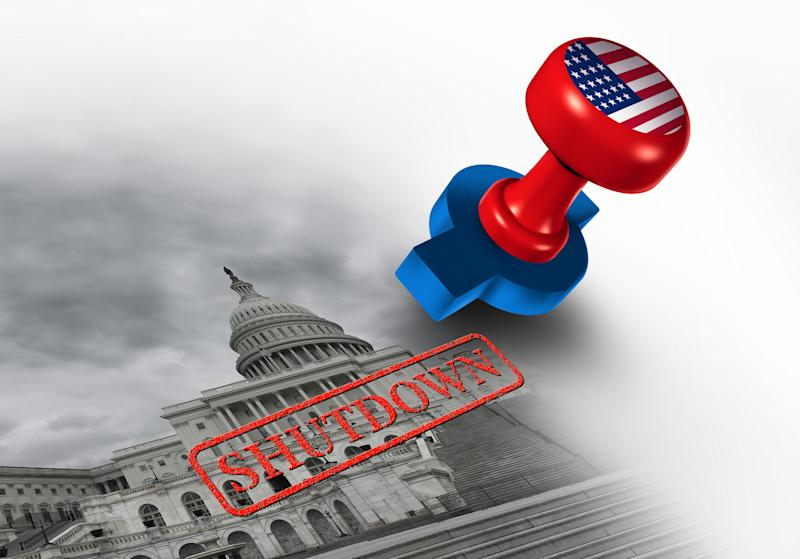 A stamp bearing the American flag imprinting the word, Shutdown, atop a black and white image of the Capitol building.