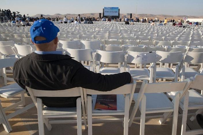 Empty chairs are seen during a ceremony to receive the delivery of two F-35 fighter jets at the Nevatim Air Force base near the southern Israeli city of Beersheva, on December 12, 2016 (AFP Photo/Jack Guez)