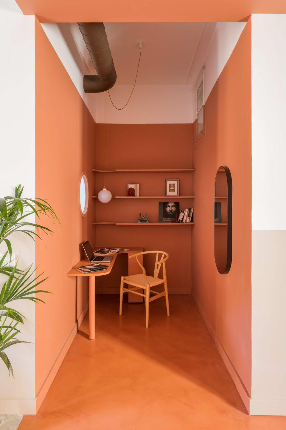 """<p>Barcelona-based architecture firm Casa has turned a tight corner office into a sunny, positive (rather than pokey) space with a lick of orange paint. By matching the desk, chair and shelving in the same colour, the effect is one of disguise – a good tip for workspaces in open-plan homes. <a href=""""https://www.colomboserboli.com"""" rel=""""nofollow noopener"""" target=""""_blank"""" data-ylk=""""slk:colomboserboli.com"""" class=""""link rapid-noclick-resp"""">colomboserboli.com</a></p>"""