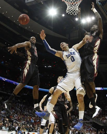 Florida State guard Michael Snaer (21) and forward Okaro White, right, with Duke guard Austin Rivers (0) work for a lose ball during the first half of an NCAA college basketball game in the semifinals of the Atlantic Coast Conference tournament, Saturday, March 10, 2012, in Atlanta. (AP Photo/John Bazemore)