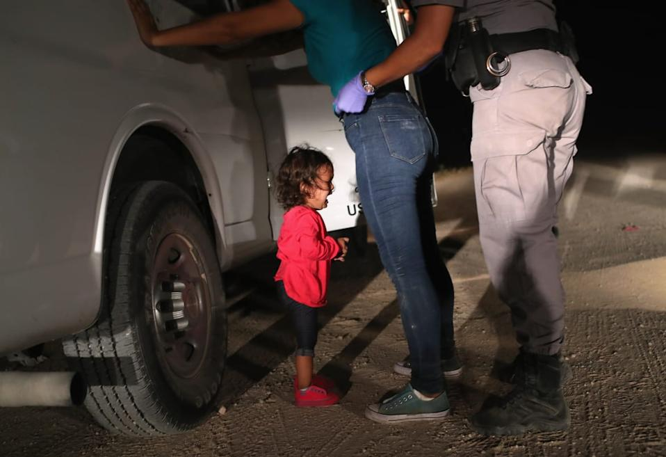 "<div class=""inline-image__caption""><p>A two-year-old Honduran asylum seeker cries as her mother is searched and detained near the U.S.-Mexico border on June 12, 2018 in McAllen, Texas. The asylum seekers had rafted across the Rio Grande from Mexico and were detained by U.S. Border Patrol agents before being sent to a processing center for possible separation. Customs and Border Protection (CBP) is executing the Trump administration's ""zero tolerance"" policy towards undocumented immigrants. U.S. Attorney General Jeff Sessions also said that domestic and gang violence in immigrants' country of origin would no longer qualify them for political asylum status.</p></div> <div class=""inline-image__credit"">John Moore/Getty</div>"