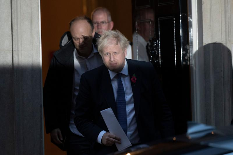 <strong>Boris Johnson and his advisor Dominic Cummings, left, leave 10 Downing Street&nbsp;</strong> (Photo: ASSOCIATED PRESS)