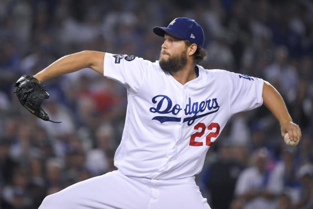 Los Angeles Dodgers pitcher Clayton Kershaw throws to a Washington Nationals batter during the seventh inning in Game 5 of a baseball National League Division Series Wednesday, Oct. 9, 2019, in Los Angeles. (AP Photo/Mark J. Terrill)