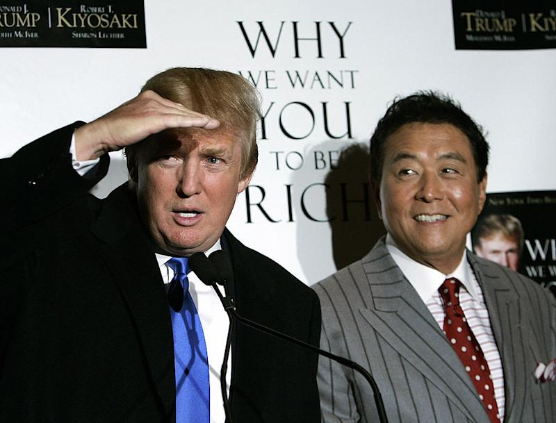 "New York, 2006: Real Estate developer and author Donald Trump (L) and author Robert Kiyosaki at a book launching party for their new book titled ""Why We Want You To Be Rich - Two Men - One Message"". (TIMOTHY A. CLARY/AFP via Getty Images)"