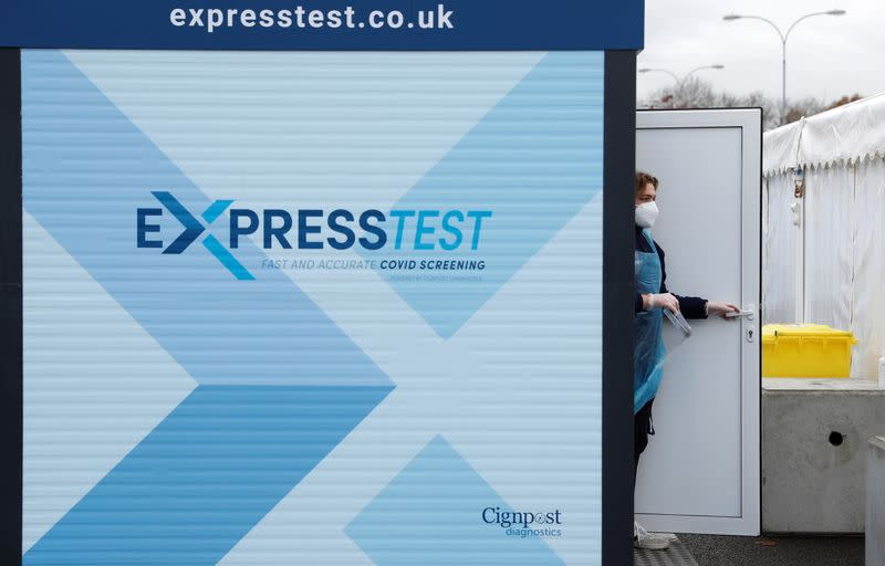 A staff member is seen at the Express Test COVID-19 testing facility at Gatwick airport, amid the coronavirus disease (COVID-19) outbreak, in Crawley