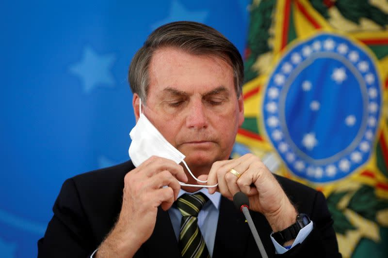 Brazil press group files criminal complaint against Bolsonaro for removing mask