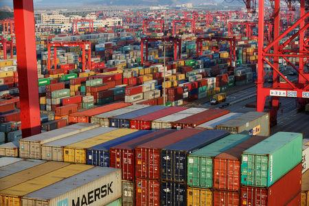 FILE PHOTO - Containers are seen at the Yangshan Deep Water Port, part of the Shanghai Free Trade Zone, in Shanghai, China September 24, 2016. REUTERS/Aly Song/File Photo