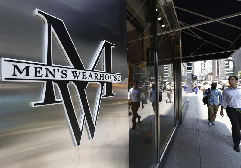 People pass by a Men's Wearhouse store in New York