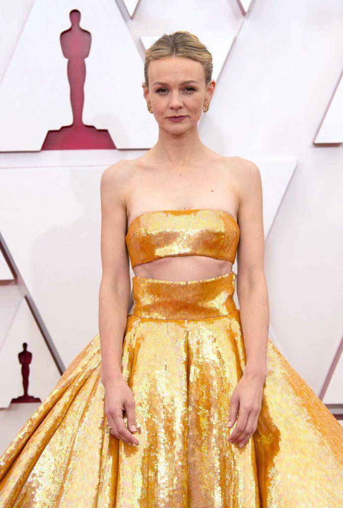 <p>Carey Mulligan's striking Valentino Haute Couture gown needed little embellishment: the star kept her beauty look classic with an elegant updo and cool-toned pink lip. </p>