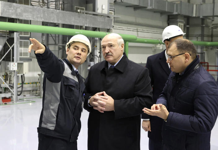 "Belarusian President Alexander Lukashenko, centre, attends the first Belarusian Nuclear Power Plant during the plant's power launch event outside the city of Astravets, Belarus, Saturday, Nov. 7, 2020. Alexander Lukashenko on Saturday formally opened the country's first nuclear power plant, a project sharply criticized by neighboring Lithuania. Lukashenko said the launch of the Russian-built and -financed Astravyets plant ""will serve as an impetus for attracting the most advanced technologies to the country and innovative directions in science and education."" (Maxim Guchek/BelTA Pool Photo via AP)"