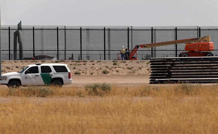 A Border Patrol unit drives by the construction site of a new section of the border wall between the US city of El Paso, Texas and Ciudad Juarez, Chihuahua state, Mexico on August 17, 2020.