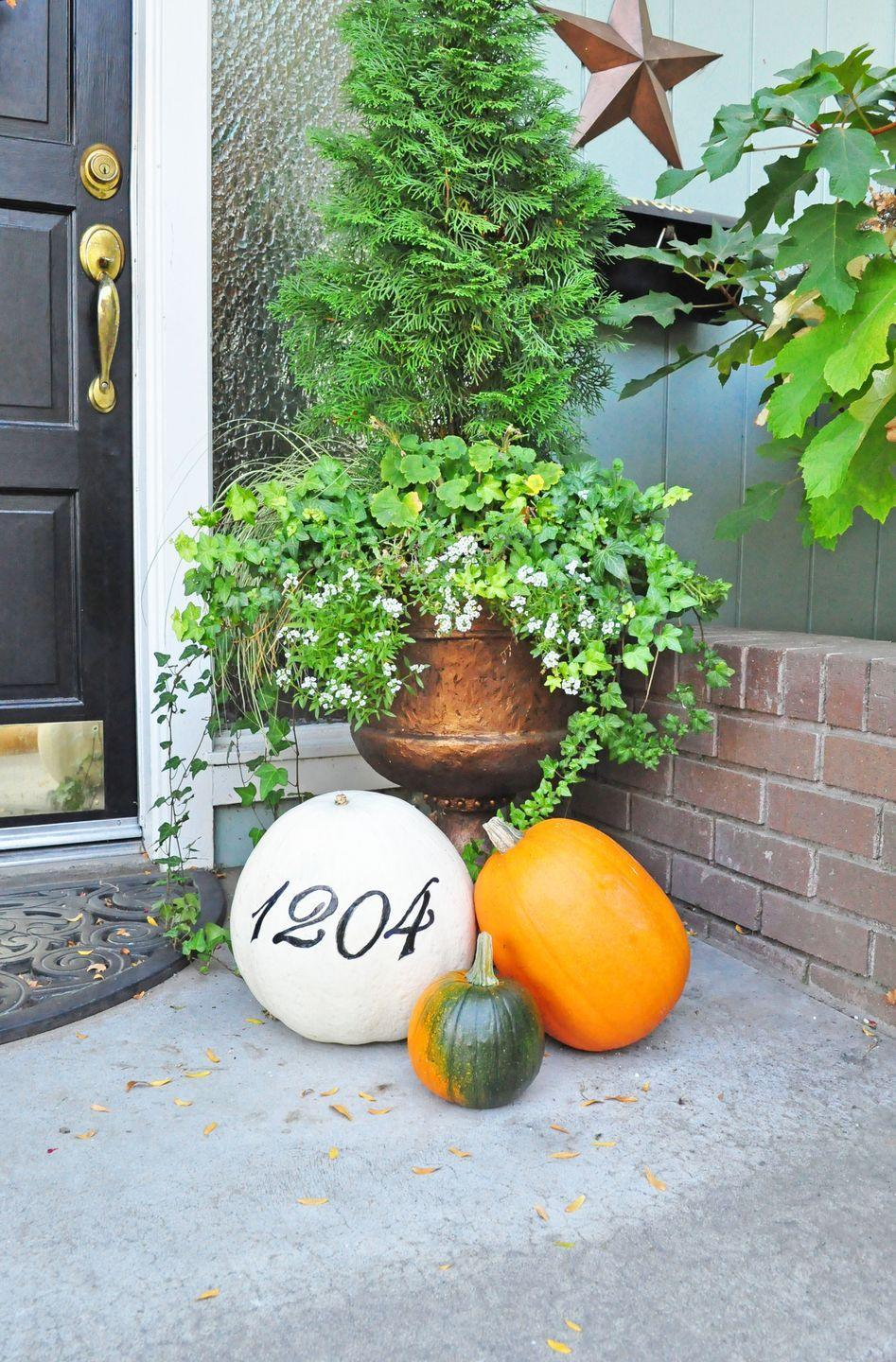 """<p>Let's make """"painting"""" even easier — Sharpie your home's digits (three coats will do it!) on a pumpkin for a sweet fall welcome.</p><p><em><a href=""""http://www.creativelylivingblog.com/2012/10/day-11-house-number-pumpkins.html"""" rel=""""nofollow noopener"""" target=""""_blank"""" data-ylk=""""slk:Get the tutorial at Creatively Living »"""" class=""""link rapid-noclick-resp"""">Get the tutorial at Creatively Living »</a></em></p>"""