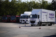 An instructor directs a learner truck driver at the National Driving Centre in Croydon, south London, Wednesday, Sept. 22, 2021. Britain doesn't have enough truck drivers. The shortage is contributing to scarcity of everything from McDonald's milkshakes to supermarket produce. (AP Photo/Matt Dunham)