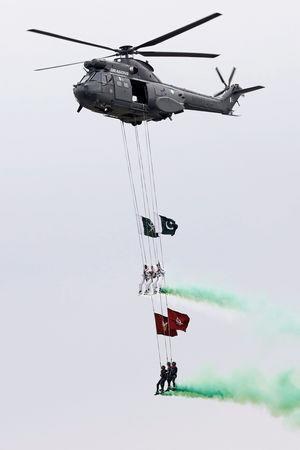 Pakistani paratroopers perform during the Pakistan Day military parade in Islamabad, Pakistan, March 23, 2019. REUTERS/Akhtar Soomro