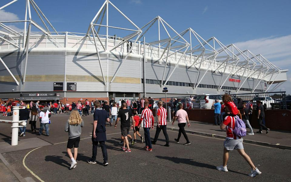 Fans make their way to the stadium ahead of the Premier League match between Southampton and Wolverhampton Wanderers - Steve Bardens/Getty Images
