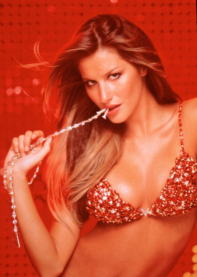 Supermodel Gisele Bundchen shows off a $15 million red hot fantasy bra set from Victoria's Secret lingerie line in 2000. The red satin bra and matching G-string panty are covered with 300 carats of Thai rubies set with diamonds and semi-precious stones. The gift includes the $3.7 million body bracelet, and a diamond belt with 76 diamonds of two carats each set in gold.