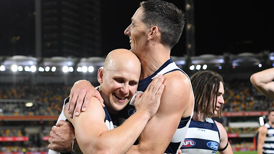 Geelong stalwarts Gary Ablett Jr and Harry Taylor are pictured embracing after the 2020 AFL grand final.