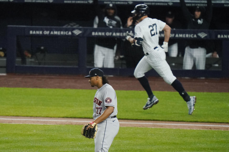 Houston Astros starting pitcher Luis Garcia (77) reacts as New York Yankees' Giancarlo Stanton (27) runs the bases after hitting a two-run home run during the third inning of a baseball game Wednesday, May 5, 2021, in New York. (AP Photo/Frank Franklin II)