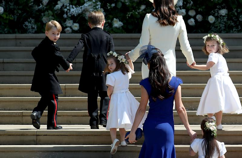 WINDSOR, UNITED KINGDOM - MAY 19: Prince George of Cambridge, Jasper Dyer, Princess Charlotte of Cambridge, Catherine, Duchess of Cambridge, Jessica Mulroney, Ivy Mulroney and Florence van Cutsem arrive at the wedding of Prince Harry and Ms. Meghan Markle at St George's Chapel at Windsor Castle on May 19, 2018 in Windsor, England. (Photo by Jane Barlow - WPA Pool/Getty Images)