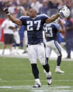 FILE - In this Oct. 31, 1999, file photo, Tennessee Titans running back Eddie George celebrates after the Titans beat the St. Louis Rams in Nashville, Tenn. The Tennessee Titans retiring Eddie George's No. 27 and the No. 9 of the late Steve McNair has turned from a simple halftime ceremony into a celebration and team reunion. (AP Photo/Mark Humphrey, File)